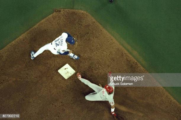 World Series Aerial view Philadelphia Phillies Darren Daulton in action sliding into second base vs Toronto Blue Jays Roberto Alomar at SkyDome Game...