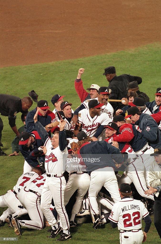 Baseball World Series Atlanta Braves victorious during on field pileup after winning game and series vs Cleveland Indians Atlanta GA