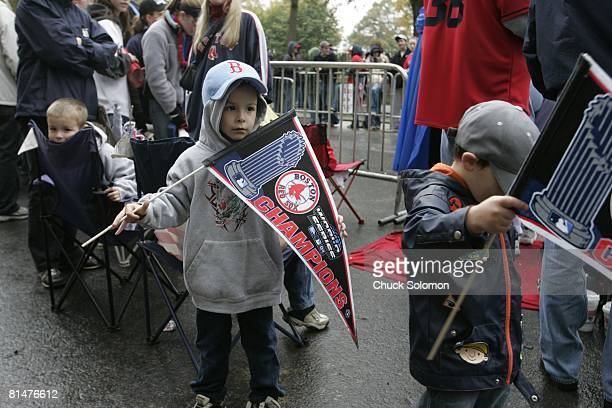 Baseball World Series Boston Red Sox fan with pennant victorious during parade Boston MA