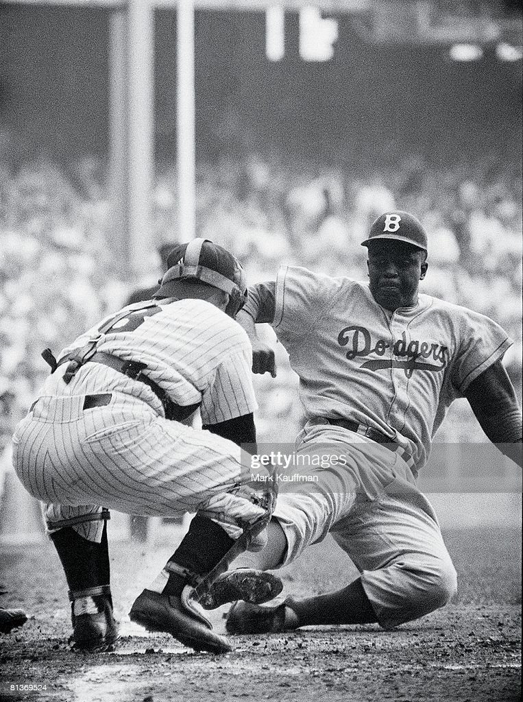 World Series, Brooklyn Dodgers Jackie Robinson (42) in action, home plate steal vs New York Yankees Yogi Berra (8), Safe at home after stolen base, Game 1, Bronx, NY 9/28/1955