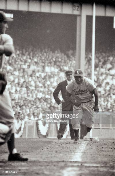 Baseball World Series Brooklyn Dodgers Jackie Robinson in action home plate steal vs New York Yankees Yogi Berra Safe at home after stolen base Game...