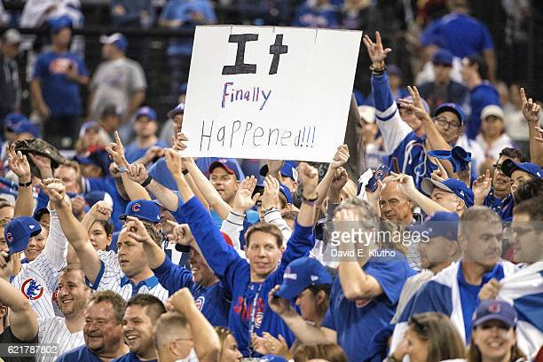 World Series Chicago Cubs fans victorious with one holding sign reading IT FINALLY HAPPENED in stands after winning Game 7 and championship series vs...