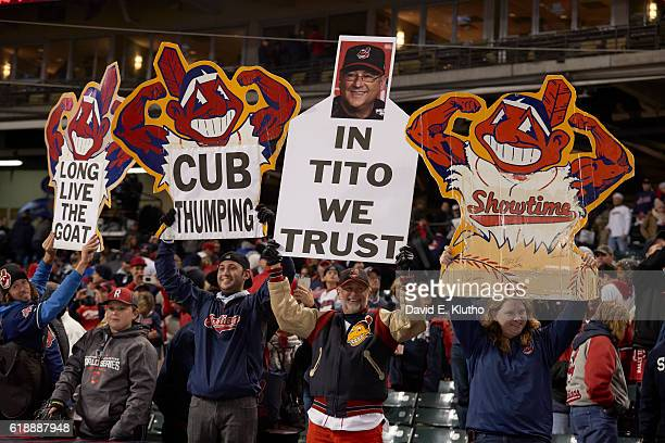 World Series Cleveland Indians fans in stands holding signs with Chief Wahoo that read LONG LIVE THE GOAT CUB THUMPING IN TITO WE TRUST and SHOWTIME...