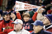 Baseball World Series Closeup of Boston Red Sox fan with 1967 WORLD SERIES pennant during game vs St Louis Cardinals Boston MA