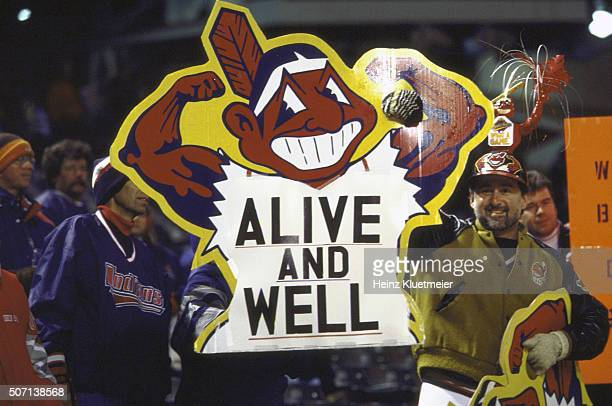 World Series Game 4 View of Cleveland Indians fans in stands holding sign with Chief Wahoo logo that reads ALIVE AND WELL during game vs Florida...