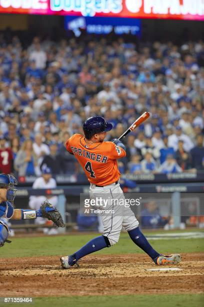World Series Houston Astros George Springer in action hitting 2run home run in 2nd inning to take 50 lead vs Los Angeles Dodgers at Dodger Stadium...