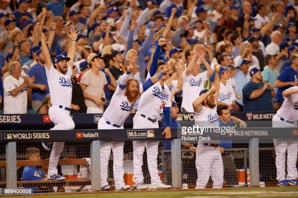 World Series Los Angeles Dodgers Charlie Culberson Justin Turner and Cody Bellinger victorious in dugout during game vs Houston Astros at Dodger...