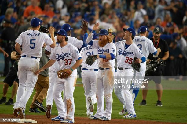 World Series Los Angeles Dodgers Charlie Culberson Justin Turner and Cody Bellinger victorious after winning game vs Houston Astros at Dodger Stadium...