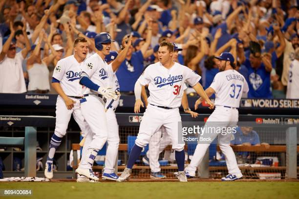 World Series Los Angeles Dodgers Cody Bellinger and Joc Pederson victorious in front of dugout during game vs Houston Astros at Dodger Stadium Game 2...