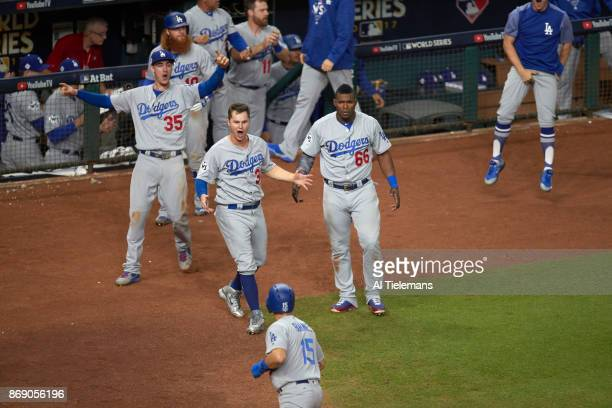 World Series Los Angeles Dodgers Cody Bellinger Joc Pederson and Yasiel Puig victorious in front of dugout during game vs Houston Astros at Minute...