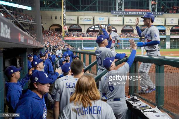 World Series Los Angeles Dodgers Cody Bellinger victorious in front of dugout with manager Dave Roberts during game vs Houston Astros at Minute Maid...