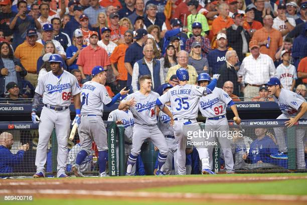 World Series Los Angeles Dodgers Joc Pederson Enrique Hernandez and Cody Bellinger victorious in front of dugout during game vs Houston Astros at...