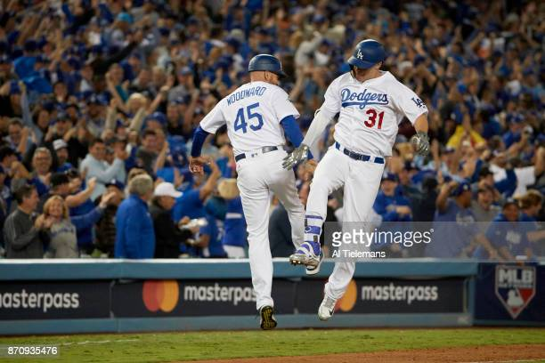 World Series Los Angeles Dodgers Joc Pederson victorious after hitting home run with third base coach Chris Woodward during game vs Houston Astros at...