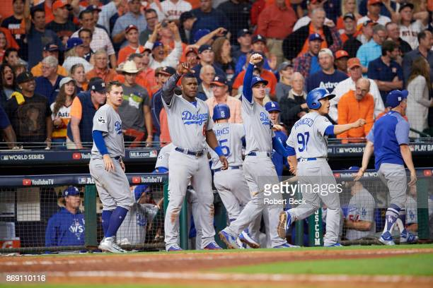 World Series Los Angeles Dodgers Joc Pederson Yasiel Puig and Cody Bellinger victorious in front of dugout during game vs Houston Astros at Minute...