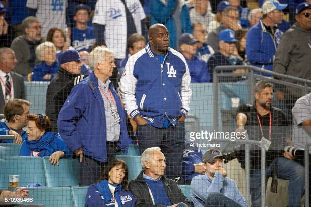 World Series Los Angeles Dodgers part owner Magic Johnson in stands with former Los Angeles Dodgers sitting in front Sandy Koufax during game vs...