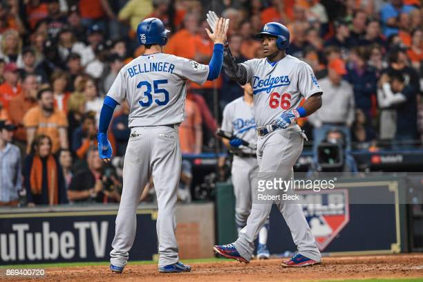 World Series Los Angeles Dodgers Yasiel Puig and Cody Bellinger victorious after home run vs Houston Astros at Minute Maid Park Game 5 Houston TX...