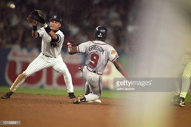 World Series New York Yankees Derek Jeter in action fielding vs Atlanta Braves Marquis Grissom Game 6 Bronx NY CREDIT John Iacono