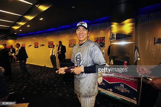 World Series New York Yankees Hideki Matsui victorious spraying champagne in locker room after winning game vs Philadelphia Phillies Game 6 Bronx NY...