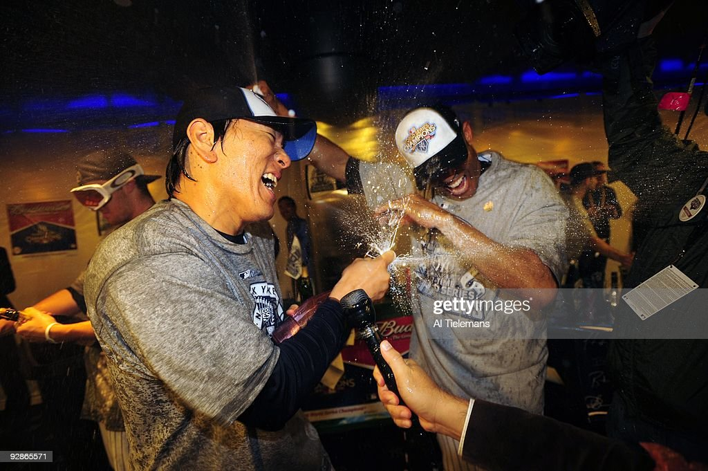 New York Yankees <a gi-track='captionPersonalityLinkClicked' href=/galleries/search?phrase=Hideki+Matsui&family=editorial&specificpeople=157483 ng-click='$event.stopPropagation()'>Hideki Matsui</a> victorious spraying champagne with <a gi-track='captionPersonalityLinkClicked' href=/galleries/search?phrase=Mariano+Rivera&family=editorial&specificpeople=201607 ng-click='$event.stopPropagation()'>Mariano Rivera</a> in locker room after winning game vs Philadelphia Phillies. Game 6. Bronx, NY 11/4/2004
