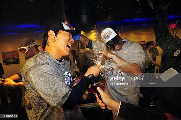 World Series New York Yankees Hideki Matsui victorious spraying champagne with Mariano Rivera in locker room after winning game vs Philadelphia...