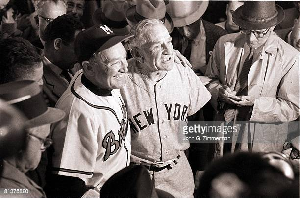 Baseball World Series New York Yankees manager Casey Stengel victorious with Milwaukee Braves manager Fred Haney during press conference after...