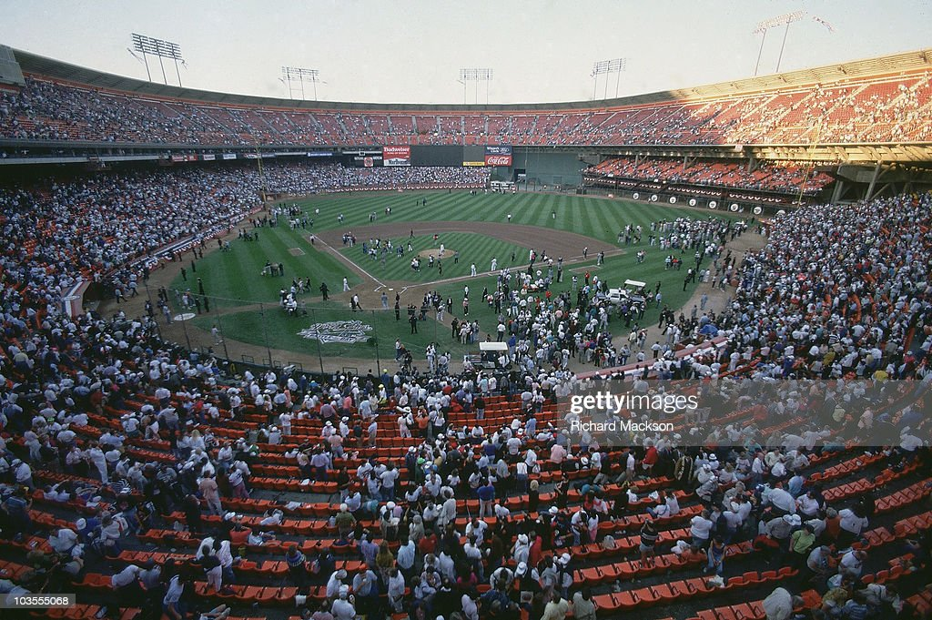 Overall view of Candlestick Park as players and fans evacuate stadium after Loma Prieta earthquake before Game 3 between San Francisco Giants and Oakland Athletics. San Francisco, CA