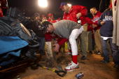 World Series Philadelphia Phillies Jamie Moyer victorious digging out pitching rubber from mound during celebration after winning game and series vs...