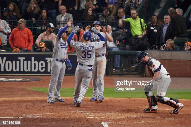 World Series Rear view of Los Angeles Dodgers Cody Bellinger victorious at home plate after hitting home run with Justin Turner and Corey Seager vs...