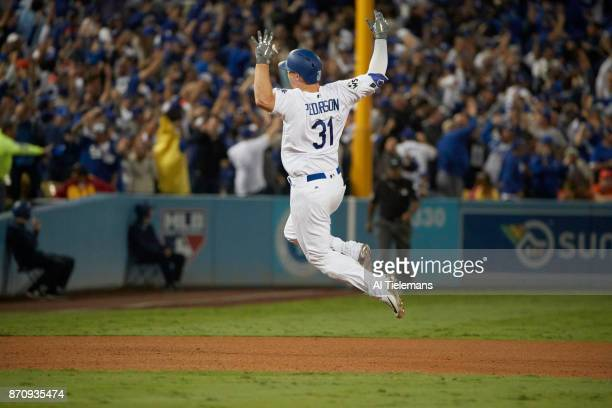 World Series Rear view of Los Angeles Dodgers Joc Pederson victorious after hitting home run vs Houston Astros at Dodger Stadium Game 6 Los Angeles...