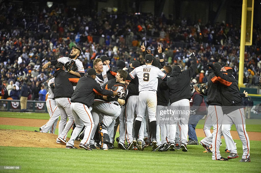 San Francisco Giants Sergio Romo (54), Hunter Pence (8), Buster Posey (28), Brandon Belt (9), and teammates victorious on field after winning Game 4 and championship series vs Detroit Tigers at Comerica Park. Cover. David E. Klutho F54 )