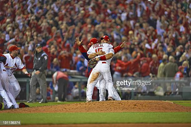 World Series St Louis Cardinals Albert Pujols victorious hugging teammate Rafael Furcal after winning Game 7 and championship series vs Texas Rangers...