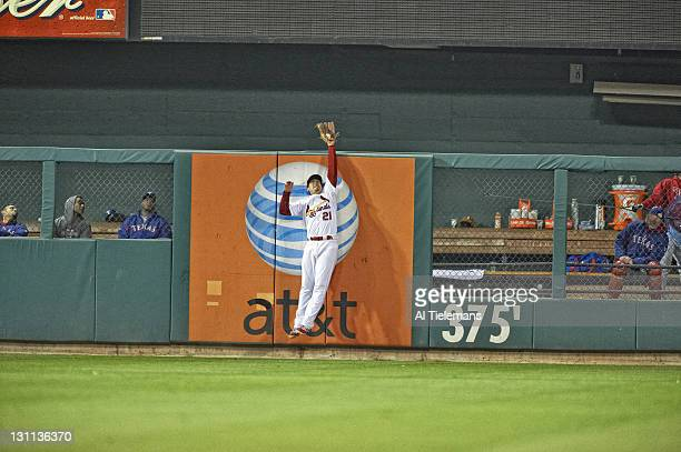 World Series St Louis Cardinals Allen Craig in action making catch against outfield wall vs Texas Rangers during 6th inning at Busch Stadium Game 7...