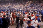 Baseball World Series St Louis Cardinals Bob Gibson and Tim McCarver victorious with team and fans after winning game vs New York Yankees St Louis MO