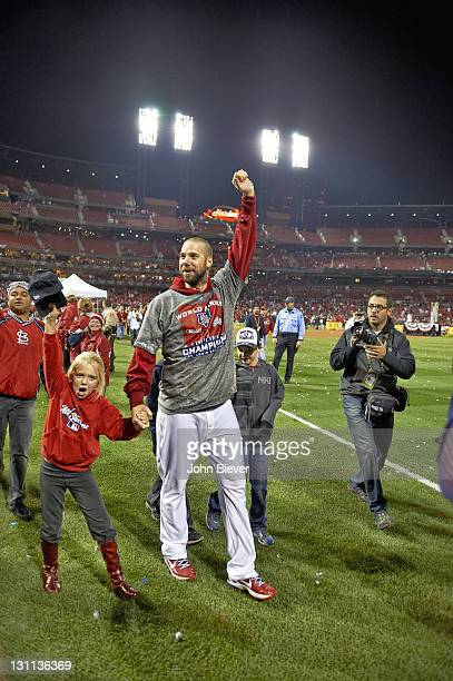 World Series St Louis Cardinals Chris Carpenter victorious with son Sam and daughter Ava during celebration after winning Game 7 and championship...