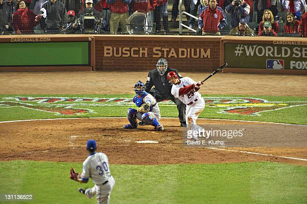 World Series St Louis Cardinals David Freese in action hitting triple during 9th inning at bat vs Texas Rangers at Busch Stadium Game 6 St Louis MO...