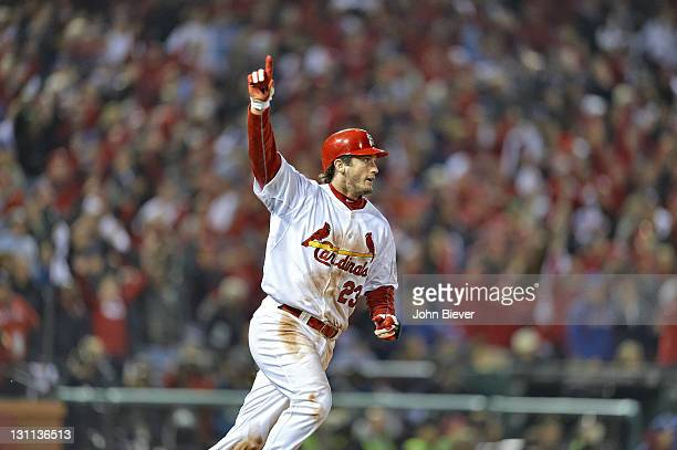 World Series St Louis Cardinals David Freese victorious after hitting game winning walk off home run vs Texas Rangers during 11th inning at Busch...