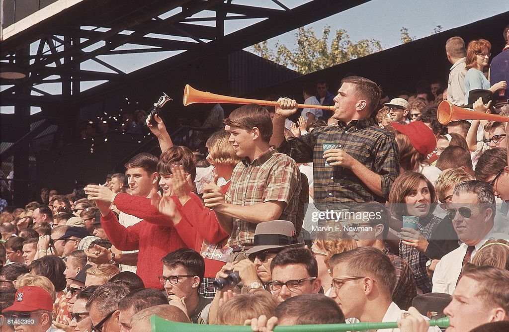 World Series, St, Louis Cardinals fans blowing horns during game vs New York Yankees, St, Louis, MO 10/8/1964