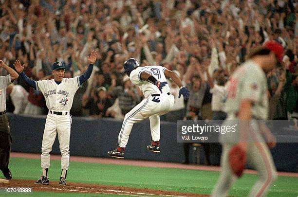 World Series Toronto Blue Jays Joe Carter victorious approaching 1st base after hitting three run game winning walk off home run during 9th inning vs...
