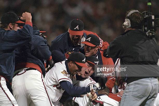 World Series View of Atlanta Braves team victorious pileup after winning game and championship series vs Cleveland Indians Cover Atlanta GA CREDIT...