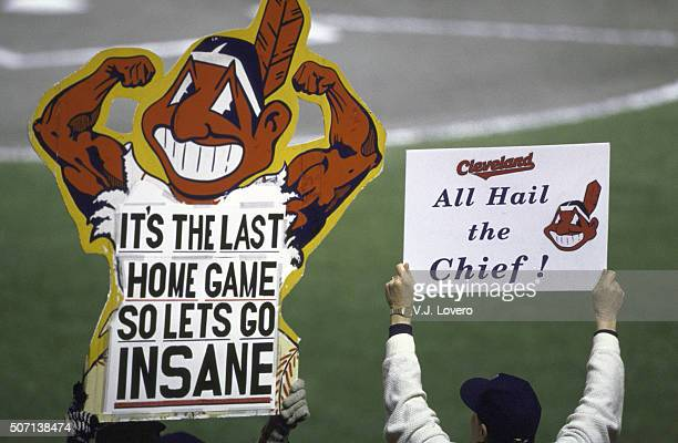 World Series View of Cleveland Indians fans in stands holding sign that reads IT'S THE LAST HOME GAME SO LETS GO INSANE with Chief Wahoo logo and ALL...