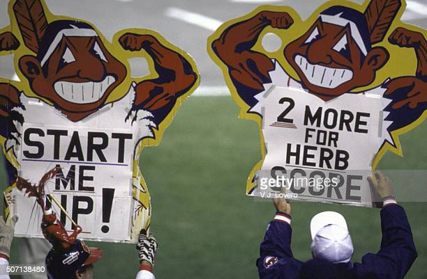 World Series View of Cleveland Indians fans in stands holding signs that read START ME UP and 2 MORE FOR HERB SCORE wirh Chief Wahoo logo during game...