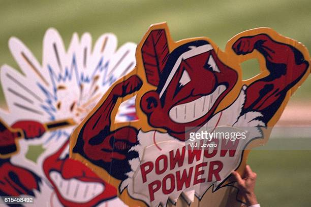 World Series View of fan in stands holding sign that reads POWWOW POWER with muscled Chief Wahoo logo during Cleveland Indians vs Atlanta Braves game...