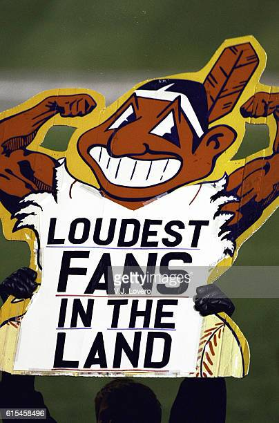 World Series View of fan in stands holding sign that reads LOUDEST FANS IN THE LAND with muscled Chief Wahoo logo during game vs Florida Marlins at...