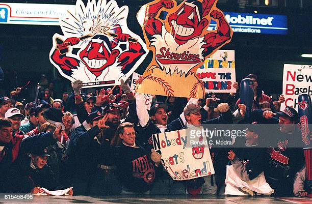 World Series View of fans in stands holding Cleveland Indians muscled Chief Wahoo logos during game vs Atlanta Braves at Jacobs Field Game 3...