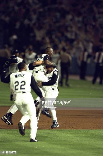 World Series View of Florida Marlins Edgar Renteria victorious on field with teammates after hitting game winning walkoff hit vs Cleveland Indians at...