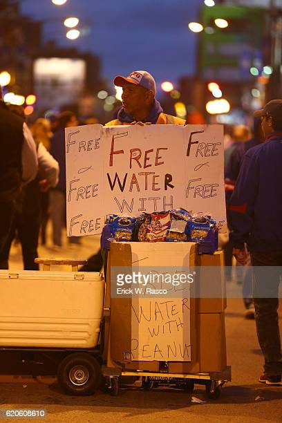 Worlds Series View of vendor offering free water with purchase of peanuts outside during Chicago Cubs vs Cleveland Indians Game 5 during photo shoot...