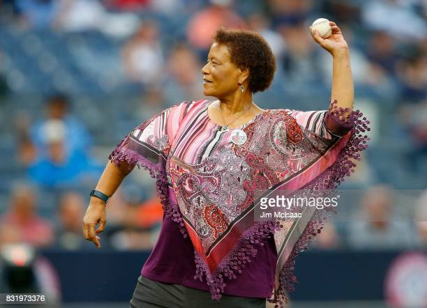 Baseball writer Claire Smith throws out the ceremonial first pitch prior to a game between the New York Yankees and the New York Mets at Yankee...