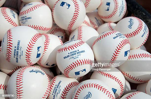 Baseballs are at the ready for warm ups as the Philadelphia Phillies face the Colorado Rockies during MLB action on Opening Day at Coors Field on...