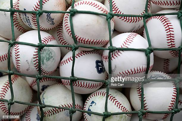 Baseballs are shown during batting practice before the start of the Opening Day game between the Baltimore Orioles and Minnesota Twins at Oriole Park...