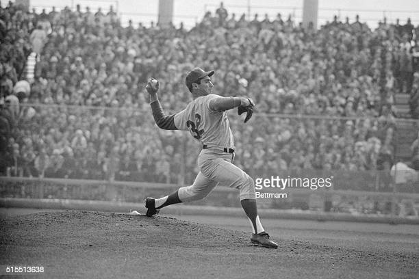 Baseball's premier hurler Sandy Koufax of Dodgers goes thru his motions against Minnesota Twins here 10/14 en route to a 3hit shutout 20 which gives...
